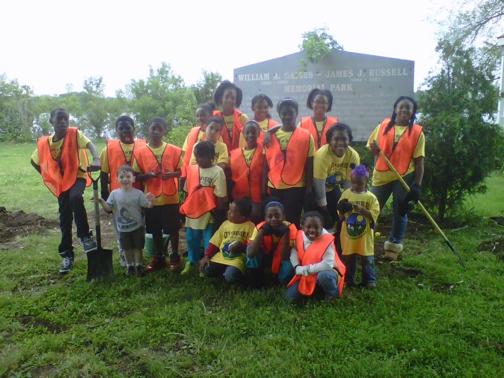 Students gathered to plant flowers and clean up the riverfront park.